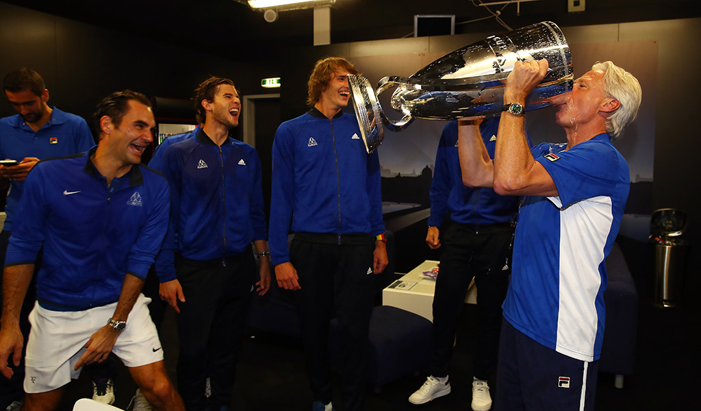 Team Europe captain Bjorn Borg drinks champagne from the Laver Cup, amusing his charges; Getty Images