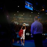 I was there for number 20. As Roger Federer completes his victory lap the spotlight reflects off the Norman Brooks Challenge Cup, making the round flare above the crowd in this photo. I decided to shoot this moment with a wide lens to capture the stadium, the crowd and the lights. (photo credit Luke Hemer/Australian Open)