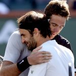 Juan Martin del Potro (R) and Roger Federer embrace at net after their thrilling Indian Wells final; Getty Images